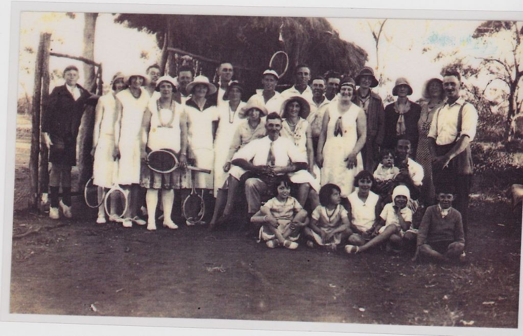 The famous tennis club .Lt-Rt. The boy on tip-toe is Arthur Stafford abt 15, (Joe's son), Elsie Howson (9th person along, next to Esme sitting next to Joe) 1930's.
