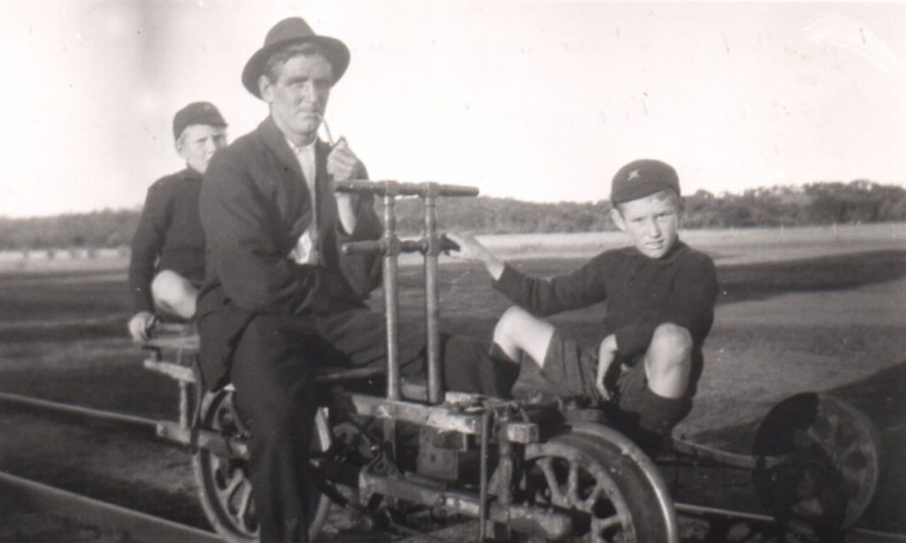 Matthew Weir seion with sons Wally (rear and Rob (front) on a railway trike in the gang at Tenindewa.