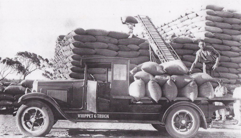 Ralph Short unloading bagged wheat at Tenindewa 1930s